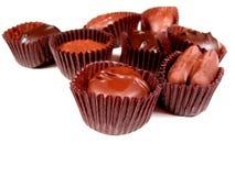 Chocolates en el blanco 6 fotos de archivo libres de regalías