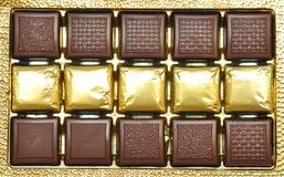 Chocolates en un rectángulo. Imagenes de archivo