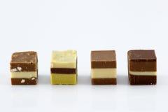 Chocolates en una fila imagen de archivo
