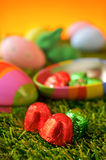 Chocolates and estar eggs on the grass Royalty Free Stock Image