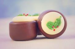 Chocolates festivos del día de fiesta de la Navidad Foto de archivo