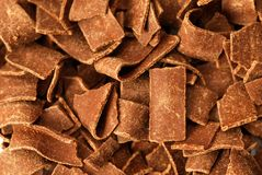 Chocolates flakes. Dark chocolate flakes all over Royalty Free Stock Photography