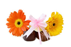 Chocolates and flowers over white Royalty Free Stock Photo