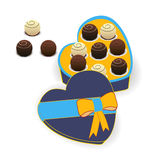 Chocolates in a gift box. A box of chocolates in shape of heart Stock Photos
