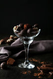 Chocolates in glass on the black background Stock Image