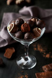 Chocolates in glass on the black background Stock Photo