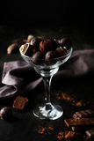 Chocolates in glass on the black background Stock Images