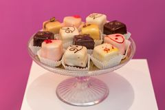 Chocolates in a glass bowl. In a shop window Royalty Free Stock Image