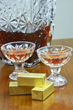 Chocolates and glasses with liquor Stock Image