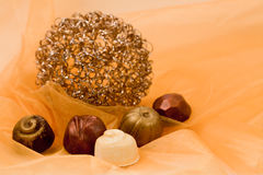 Chocolates and Gold Royalty Free Stock Photos