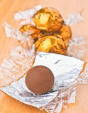 Chocolates in gold Royalty Free Stock Photos