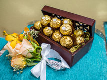 Chocolates in Gold Foil in a box on a velvet pillow as a wedding Stock Images