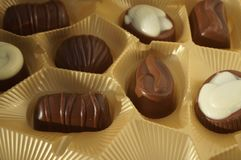 chocolates in gold packaging stock photo