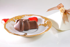Chocolates on  golden saucer. Stock Photography