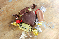 Chocolates. With heart shape with other wrapped candies on rustic wooden background Stock Photography