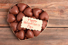 Chocolates in heart-shaped box. Royalty Free Stock Images