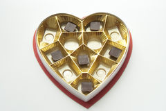 Chocolates in a Heart shaped tin and box Royalty Free Stock Photos