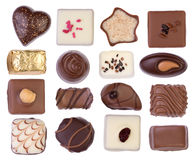 Chocolates isolados no fundo branco Fotografia de Stock