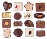 Chocolates isolados no fundo branco fotografia de stock