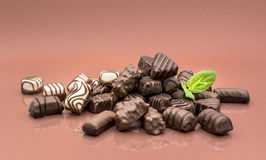 Chocolates and mint Stock Photos
