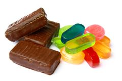 Chocolates and multi-coloured sweets Stock Image