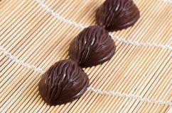 Chocolates next to each other Stock Photos