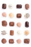 Chocolates no branco Fotos de Stock