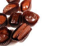 Chocolates no branco 9 foto de stock