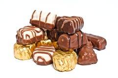 Chocolates no fundo branco Imagem de Stock