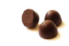 Chocolates no fundo branco Fotografia de Stock Royalty Free