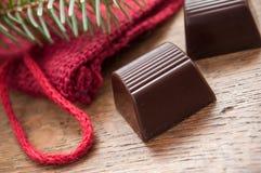 Chocolates no fundo de madeira da tabela Foto de Stock