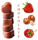Chocolates with nuts and berries.. Photo-realistic  illustration of chocolates. Heart-shaped chocolates with nuts and berries Stock Photos
