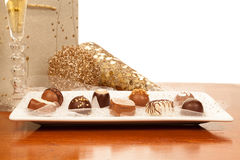 Chocolates, oro, y Champán Imágenes de archivo libres de regalías