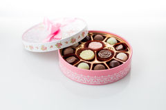 Chocolates in pink box on white background Royalty Free Stock Photography