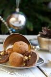 Chocolates with pistachio praline, cognac and liqueur Stock Photos