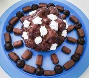 Chocolates and profitteroles. Chocolates - almond, coconut, hazelnuts with milk, dark and white choccolate Stock Image