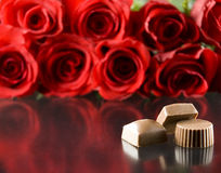 Chocolates with red roses Stock Images