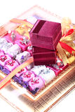 Chocolates and ring boxes Royalty Free Stock Photos