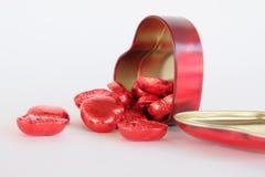 Chocolates rojos del corazón aclamación Fotografía de archivo