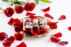 Chocolates and roses Stock Image