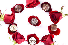 Chocolates and roses Stock Images