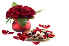 Chocolates and roses Stock Photography