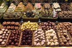 Chocolates and sweets for sale. Variety of finest selection chocolates and sweets for sale at la Boqueria market in Barcelona, Spain. Food background royalty free stock image