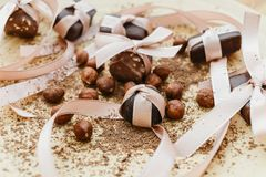 Chocolates, tied up with ribbons stock image
