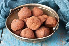 Homemade chocolate truffles. Chocolates Truffles  in vintage plate on wooden background Royalty Free Stock Photos