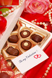 Chocolates for Valentine. Box of  chocolates with love card for Valentine`s day Royalty Free Stock Photo