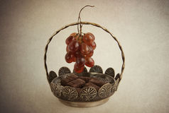 Chocolates in vase and grapes Royalty Free Stock Photo