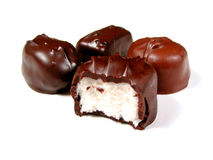 Chocolates on white, one bitten royalty free stock images