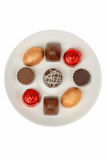 Chocolates on a white plate royalty free stock images