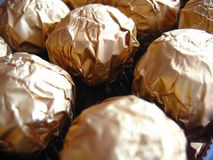 Chocolates wrapped in foil. A closeup of chocolate balls, wrapped in bronze foil Royalty Free Stock Image